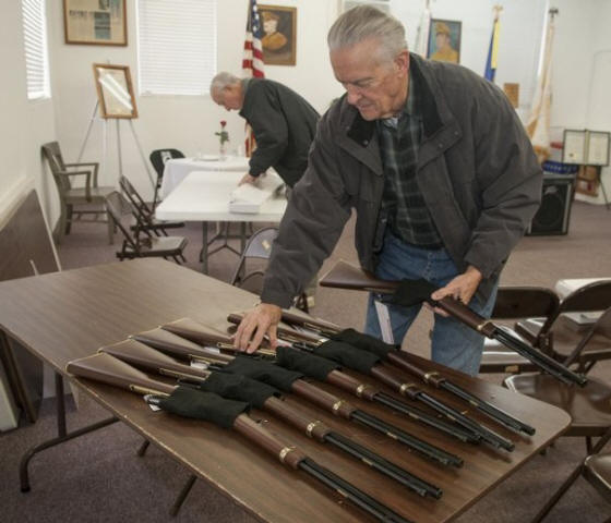 photos by J. MILES CARY/NEWS SENTINEL Loudon County Veterans Honor Guard member Russ Heimforth unpacks new rifles Monday at the Lenoir City War Memorial Building. The Henry Repeating Rifle Co. donated seven lever-action rifles to be used by the honor guard for conducting salutes at military funerals. The new .22-caliber guns will replace World War II-era M1 Garand rifles the honor guard has been using for more than 60 years.